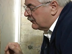 Silver daddy working a big, uncut glory hole cock...